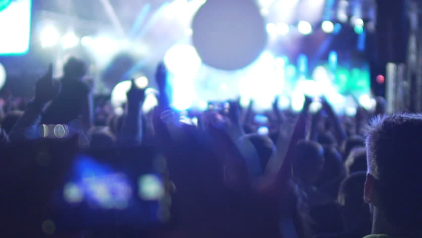 Females hands filming music band performance on contemporary smartphone, slowmo | Shutterstock HD Video #26429192