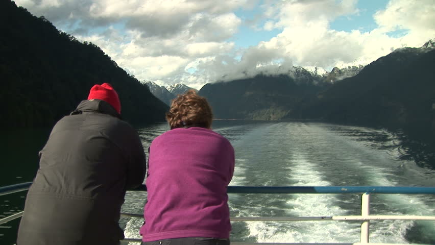 Senior couple gazing the wakes during a boat trip on lake | Shutterstock HD Video #2643035