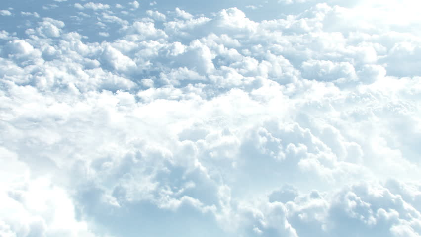 CGI 3D animation of flying through big white clouds high in sky