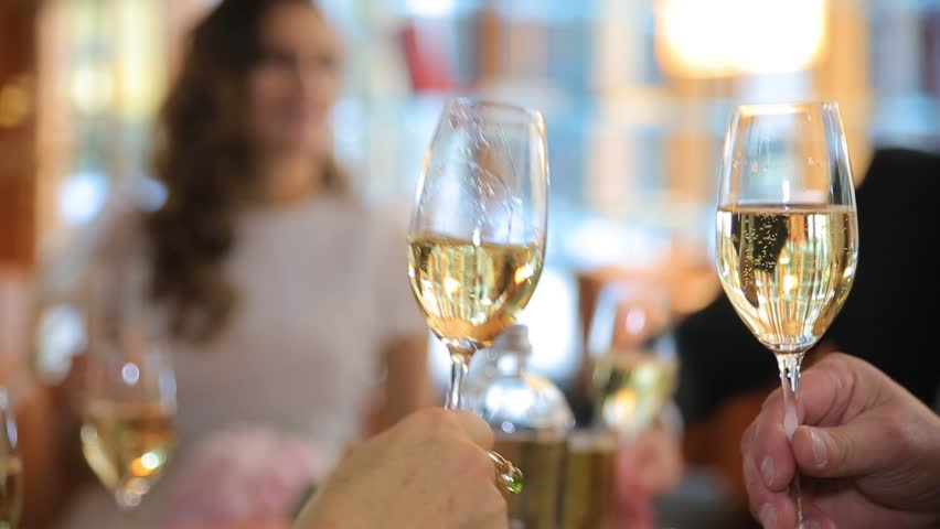 Hands holding glasses and toasting, People cheers with a glass of champagne. happy festive moment, luxury celebration concept. Clinking glasses of champagne in hands | Shutterstock HD Video #26441807