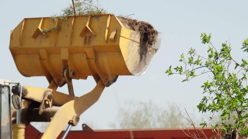 Wheel loader excavator loading construction garbage in a dump truck. 4K UltraHD video footage #26446805