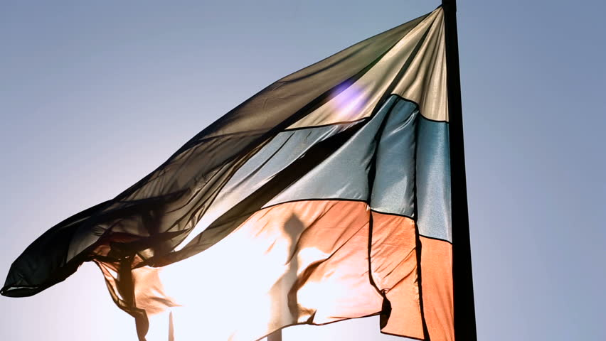 Close-up shot of flags of Russian Federation waving in the wind on a background blue sky. HD #26446937