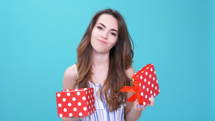 Young woman angry about bad gift isolated