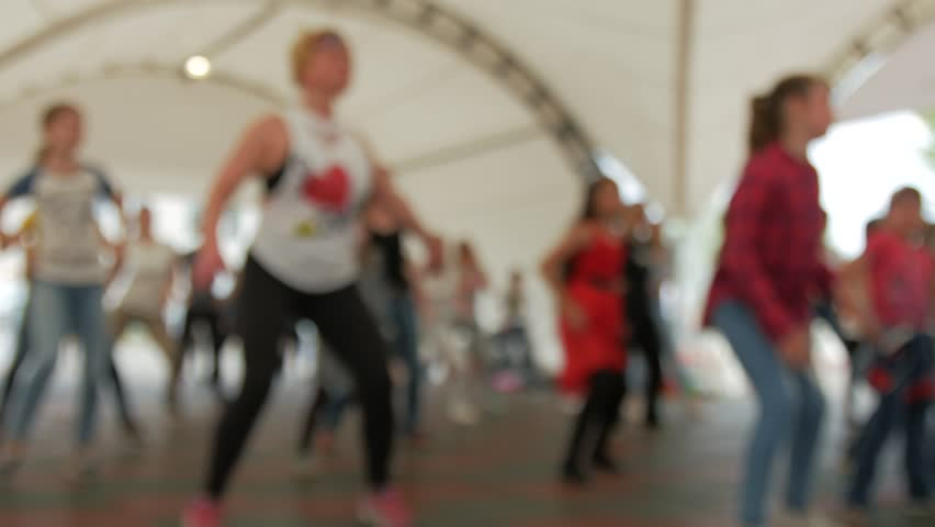 Group of people engaged in fitness. Workout Zumba. Blurred background. Royalty-Free Stock Footage #26477777
