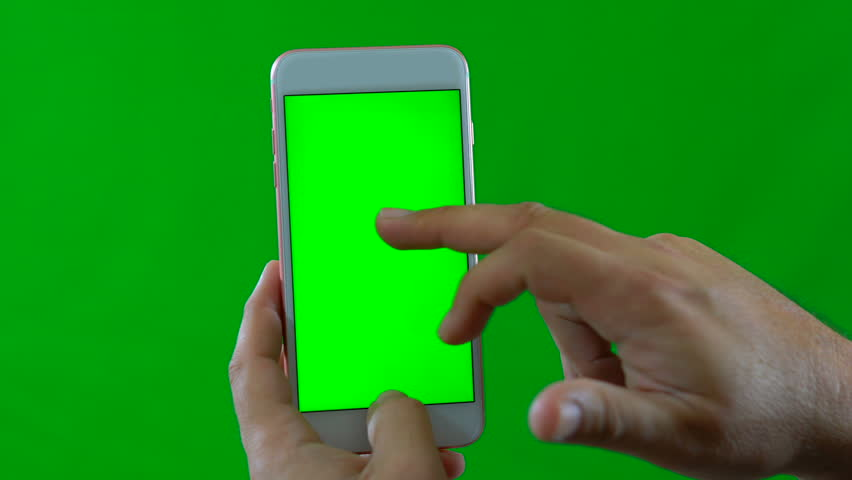 Man using modern white smart phone, swiping and touching, front facing, against green screen. | Shutterstock HD Video #26480456