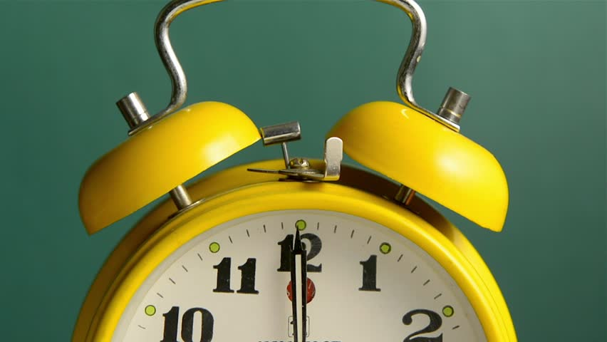 Old fashioned alarm clock ringing on the hour