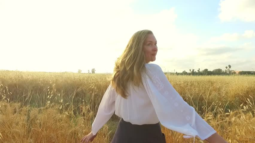 Following young girl in wheat field.  Freedom   Shutterstock HD Video #26489795