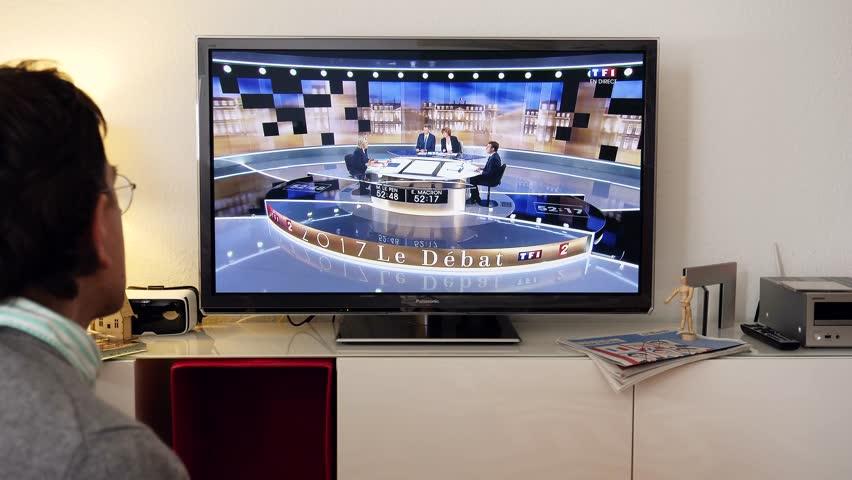 PARIS, FRANCE - MAY 03, 2017: Man watching debate between Emmanuel Macron and Marine Le Pen | Shutterstock HD Video #26495429