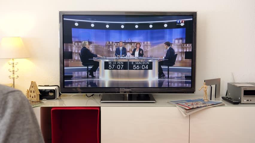 PARIS, FRANCE - MAY 03, 2017: Supporter of President watch debate between Emmanuel Macron and Marine Le Pen | Shutterstock HD Video #26495504