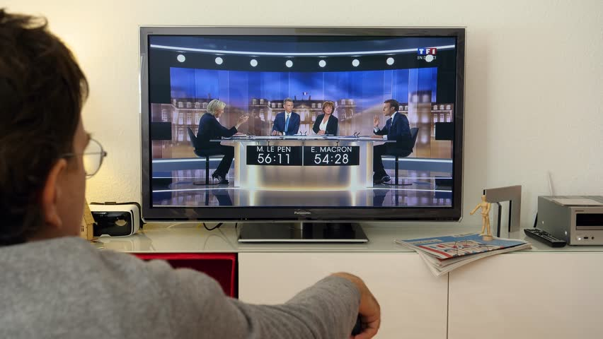 PARIS, FRANCE - MAY 03, 2017: Supporter of President watch E Macron talking to M Le Pen about Judges in France - debate between Emmanuel Macron and Marine Le Pen | Shutterstock HD Video #26495546