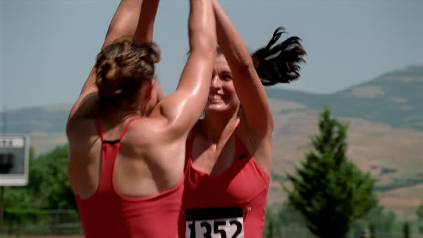 Happy female relay racers congratulating each other before turning to shake hands with rivals | Shutterstock HD Video #26501231