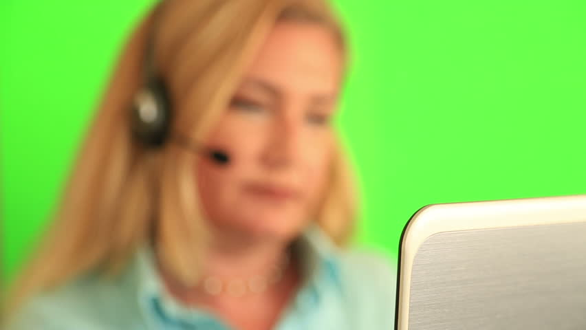 Support phone operator in headset speaking on chroma key green screen background | Shutterstock HD Video #26508383