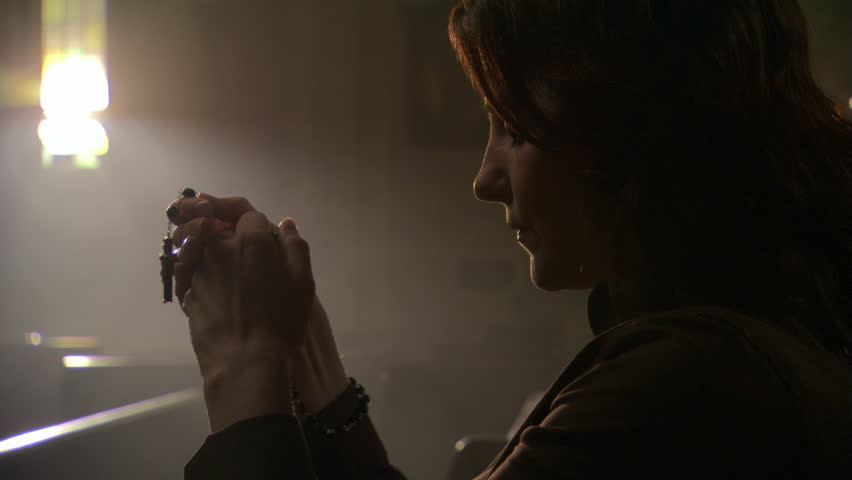 Close view of woman holding rosary and praying   Shutterstock HD Video #26509250