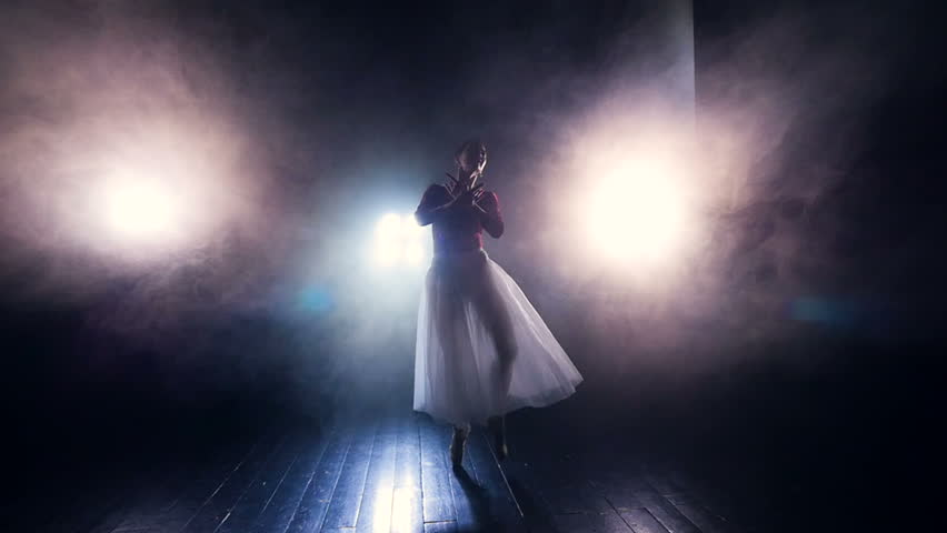 Ballerina moving in the fog. Silhouette. Steadicam. HD. #26509940