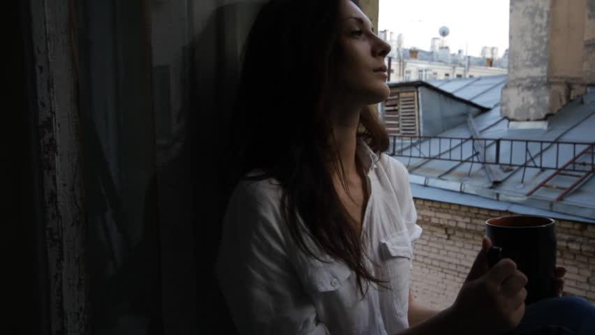 Beautiful woman at a window slider | Shutterstock HD Video #2651393