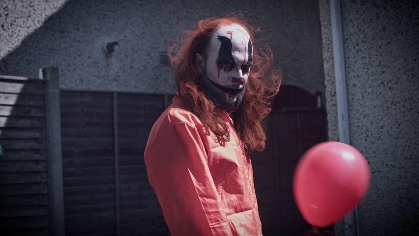 4k Halloween Horror Clown Man with Balloon | Shutterstock HD Video #26545961