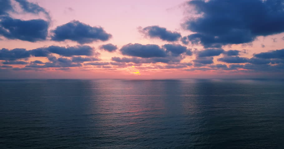 Brightly colored sunset over the calm Mediterranean Sea. Drone Point of View . Night  | Shutterstock HD Video #26553344