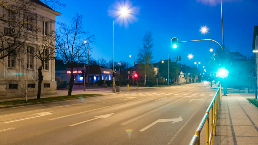 Busy city intersection or crossing with lights and cars at dusk time lapse. | Shutterstock HD Video #26558597