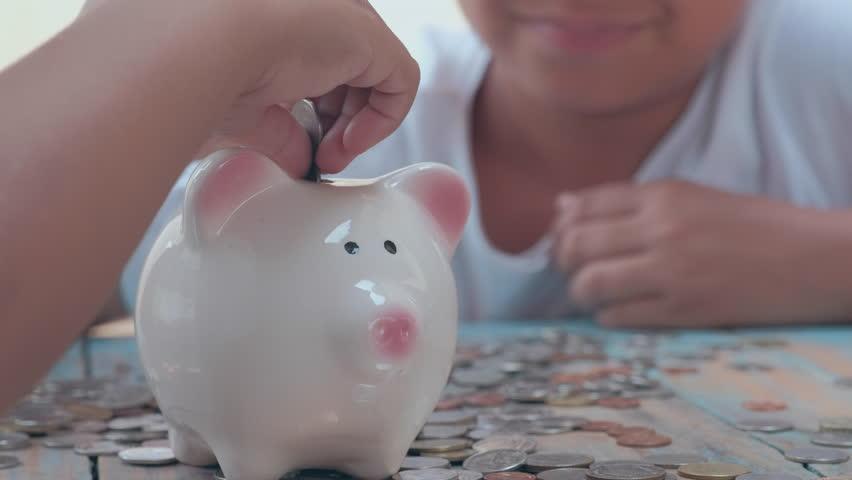 Saving money, selective focus, vintage  | Shutterstock HD Video #26577590
