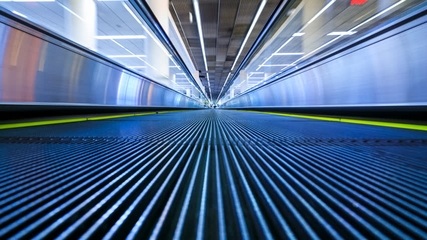 4K Motion blur timelapse of moving escalator in the airport