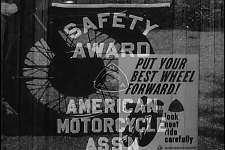 1960s: A motorcycle is given a safety check, by a motorcyclist, in 1965.   Shutterstock HD Video #26593529