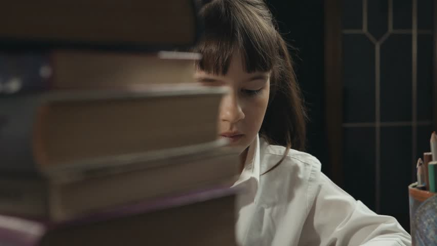 Eight years school girl writing in her notebook, studying place with books and globe, education concept, 30FPS | Shutterstock HD Video #26596814