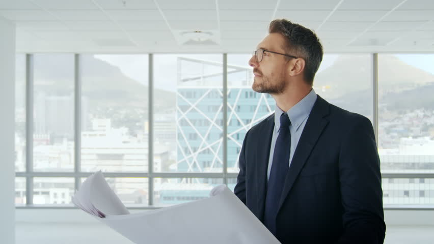 Male Architect In Modern Empty Office Looking At Plans | Shutterstock HD Video #26608775