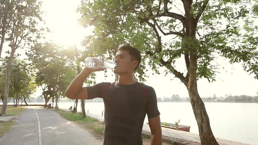 Men drink water after running.