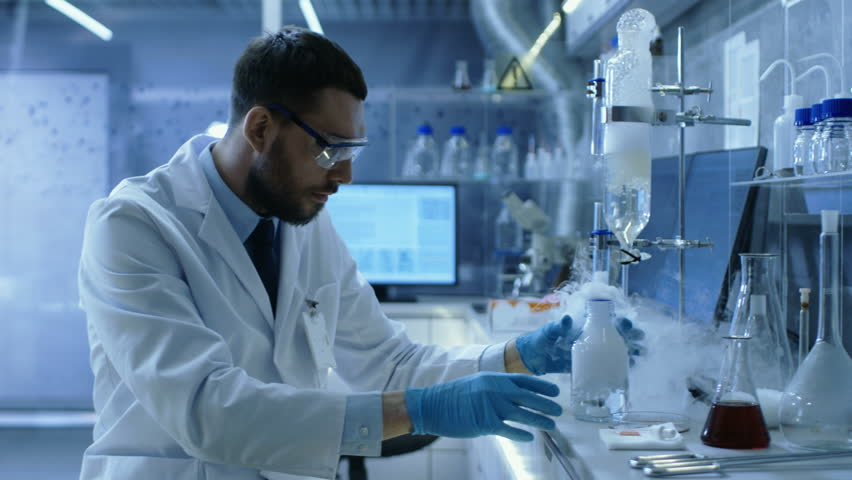 In a Chemical Research Laboratory Scientist Mixes Smoking Compounds in Beakers.  Shot on RED EPIC-W 8K Helium Cinema Camera. | Shutterstock HD Video #26643625