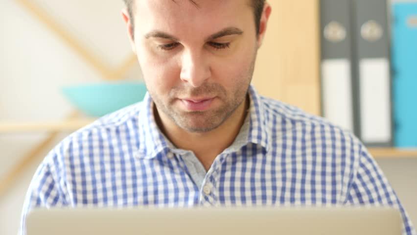 Headache, Man Working on Laptop, Front View Close Up | Shutterstock HD Video #26649061