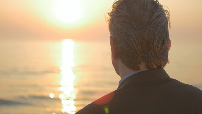 Close-up of mature businessman looking to the sun by the sea and thinking. Concept of middle-age man making his retirement's plans. | Shutterstock HD Video #26666425
