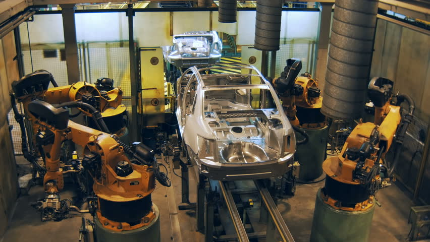robots are welding the car body, making car body on a automobile factory