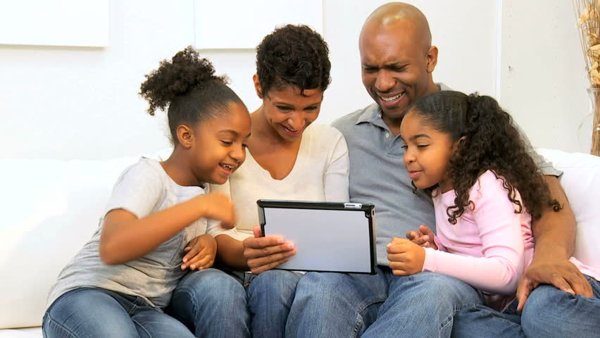 Young African American parents home daughters using touch screen tablet technology | Shutterstock HD Video #2666936
