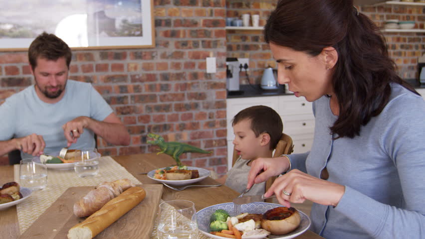Family Eating Meal In Open Plan Kitchen Together | Shutterstock HD Video #26680093