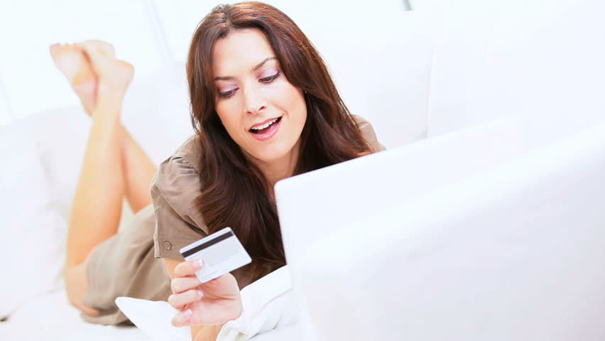 Caucasian female makes a purchase on a laptop computer Royalty-Free Stock Footage #2668631