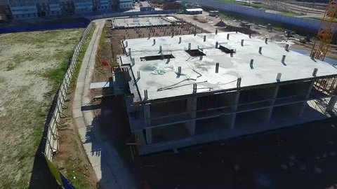 Around the building under construction in a circle. Panorama of the construction site from the bottom to the top.
