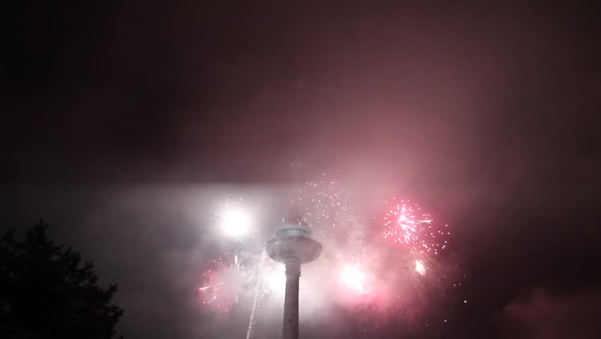 Lithuania, Vilnius television tower with a firework, 2011/12/31, Vilnius, Lithuania