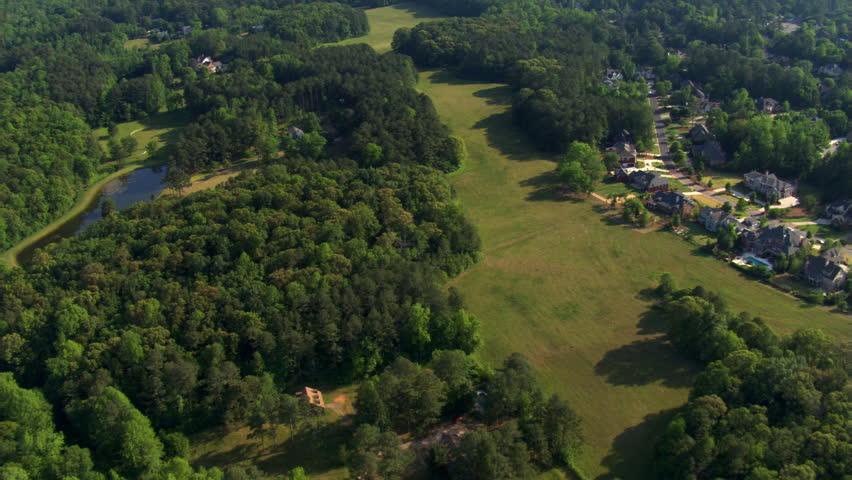 Flight above homes near golf course in suburban Atlanta, Georgia. Shot in 2007.