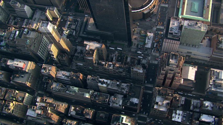 Flight looking down onto Manhattan rooftops and streets. Shot in 2003. | Shutterstock HD Video #26705158