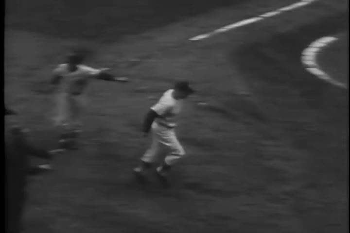 1950s: The New York Yankees play the Brooklyn Dodgers in a World Series with players Mickey Mantle, Sal Maglie, Yogi Berra, Gil Hodges, Dale Mitchell and Don Larsen, who pitches the first no hitter