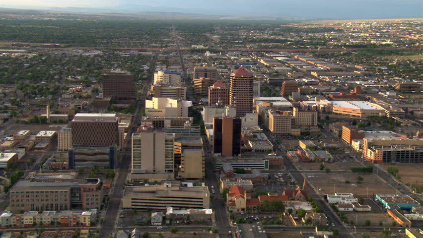 Wide orbit of Albuquerque with Sandia Mountains behind cityscape. Shot in 2008.