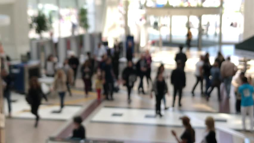 Blurry Customers entering the mall center through security and revolving doors #26749879