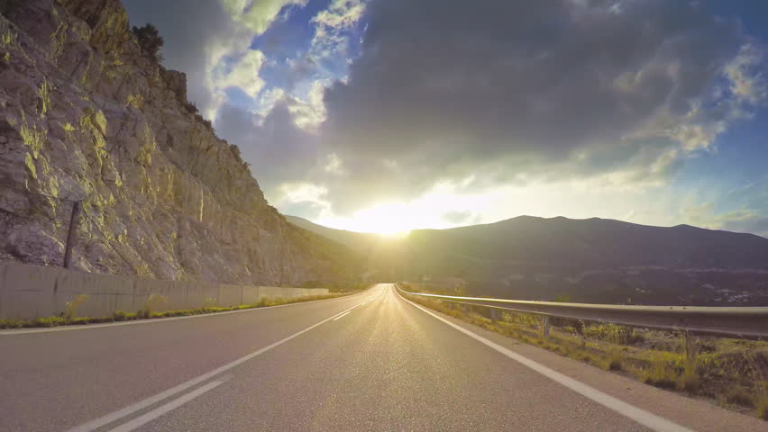 POV vehicle drive across beautiful remote mediterranean nature, sun light flashing cloudy sky, coastal curvy road, point of view car travel | Shutterstock HD Video #26777905