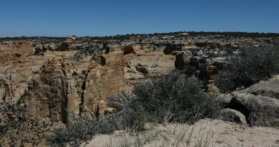 Utah San Rafael Swell deep desert canyon landscape slide. Geologic landscape sandstone towers, valleys and canyons. Off road all terrain 4x4 vehicles ATV. Dangerous wilderness environment. | Shutterstock HD Video #26793829
