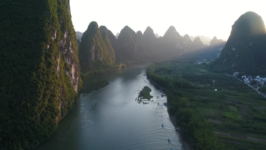Aerial view of sunset over karst mountain landscape of Yangshuo, Guangxi province, China. Li River and karst mountains top view. Travel, adventure and picturesque famous destination concept