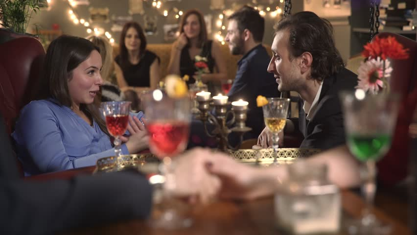 Portrait of Young couple makes a toast in a very crowded pub | Shutterstock HD Video #26818945