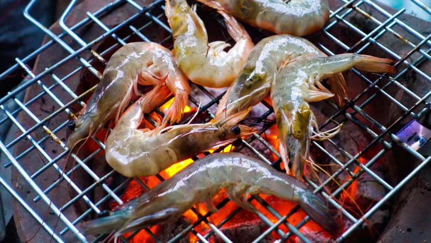 Delicious shrimp on grill with flames   Shutterstock HD Video #26825194