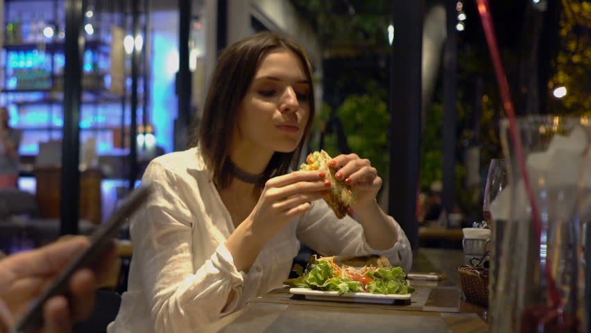 Young Woman Eating Tasty Meal Stock Footage Video (100% Royalty-free) 26839462   Shutterstock