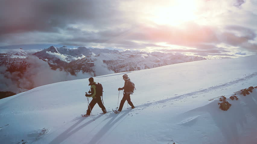 aerial view of two male hikers walking in untouched snow mountain landscape. aventures journey trip scenery of people climbing together on extreme winter expedition tour  Royalty-Free Stock Footage #26843110