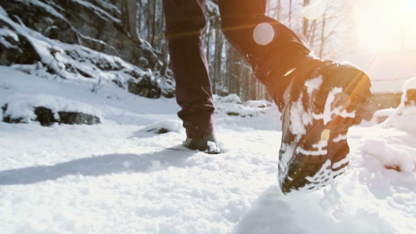 feet walking in deep snow shot in slow motion. foot steps of hiker. recreational winter activity outdoors #26843116